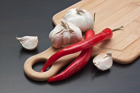garlic and red chili peppers on the kitchen table Stock Photo - 12951572