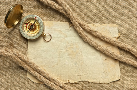 Vintage background with old paper and compass Stock Photo