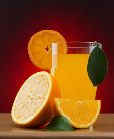 orange and juice on a table Stock Photo - 12951668