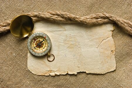 Vintage background with old paper and compass Stock Photo - 12951741