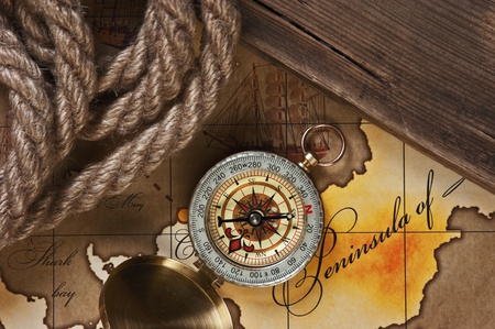 compass and rope on a map photo