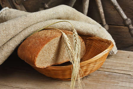 slices of rye bread and ears of corn on the wooden table Stock Photo - 13028790