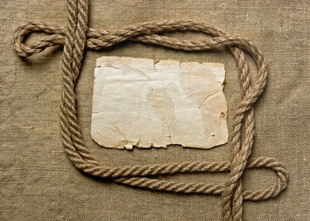 old paper and rope on canvas, frame photo