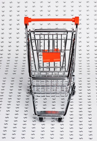 shopping trolley on the background of the icons of money photo