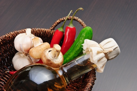 vegetables and a basket with a bottle of vinegar Stock Photo - 13145517