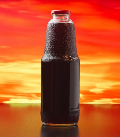 bottle of pomegranate juice at sunset Stock Photo - 13231595