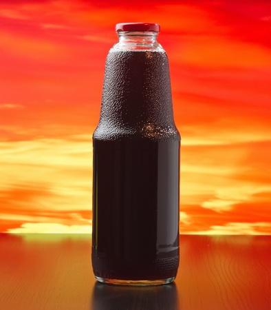 bottle of pomegranate juice at sunset Stock Photo - 13231595