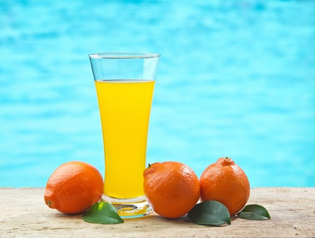 tangerine and juice  on a beach table  photo