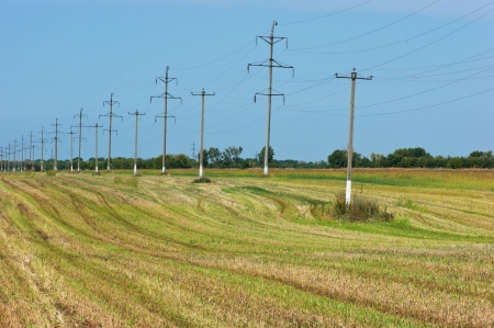 High voltage power pole on the field photo