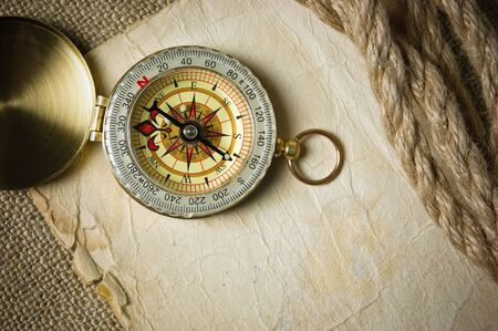 vintage compass: Vintage background with old paper and compass Stock Photo