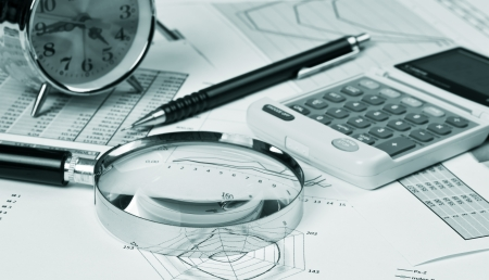 home finance: gold clock and office supplies on the table