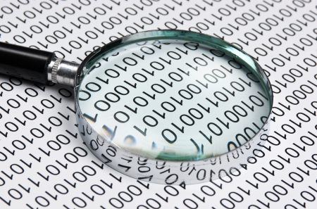 magnifying glass on the background of a binary code Stock Photo - 15125684