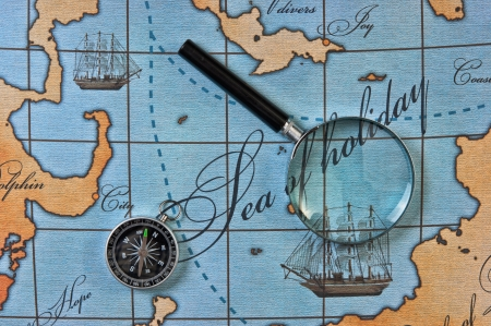 magnifier and compass on a stylized map Stock Photo - 15178560