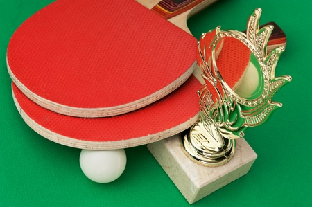 forehand: sports awards and  tennis racquets on a green table Stock Photo