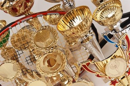 awards ceremony: many sports awards and a tennis racket
