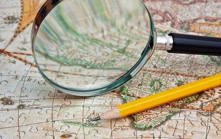 magnifying glass and a pencil on a map Stock Photo - 15178546