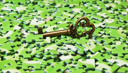 key on pile of green puzzle Stock Photo - 15302373