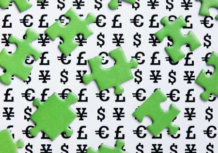 green puzzles and symbols of money Stock Photo - 15325487
