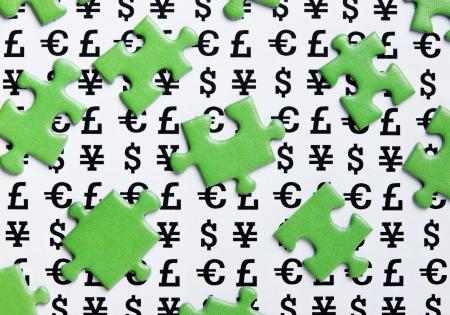 ecomomical: green puzzles and symbols of money