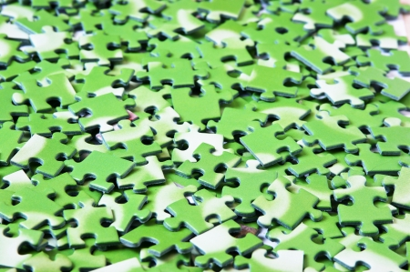 a pile of green puzzle, background