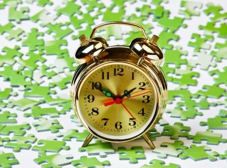 ecomomical: alarm clock on the green puzzle