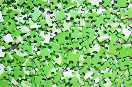 ecomomical: a pile of green puzzle, background