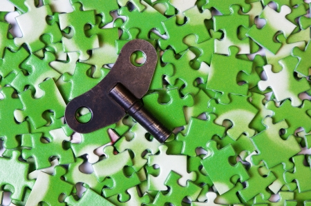 key on pile of green puzzle Stock Photo - 15392482