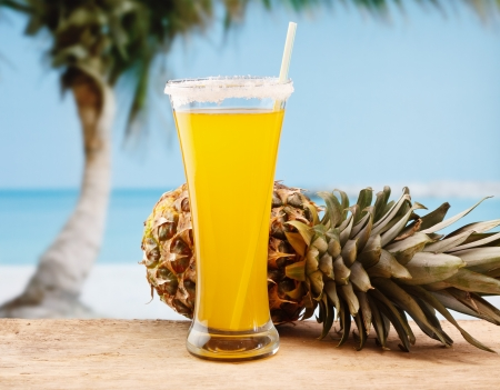 pineapple juice and pineapple on the beach Stock Photo - 15399531