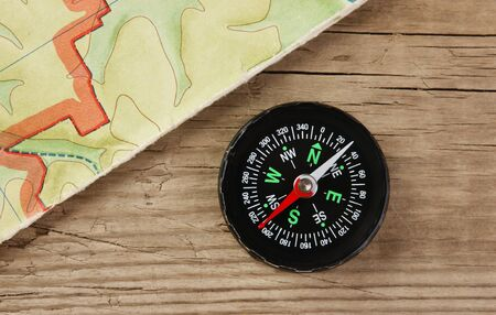 old map and compass on a wooden board photo