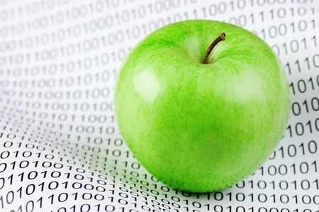 green apple on a binary code photo