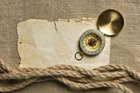 Vintage background with old paper and compass Stock Photo - 15614615