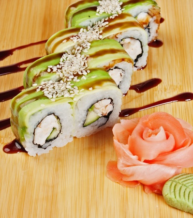 Asian food sushi on wooden plate isolated on white background Stock Photo - 15614605