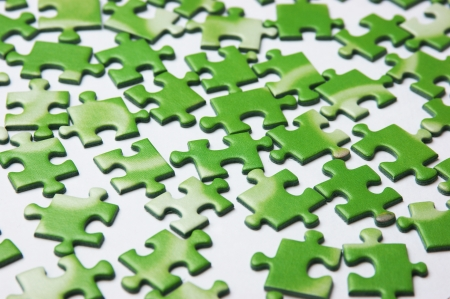 ecomomical: scattered green puzzle, background