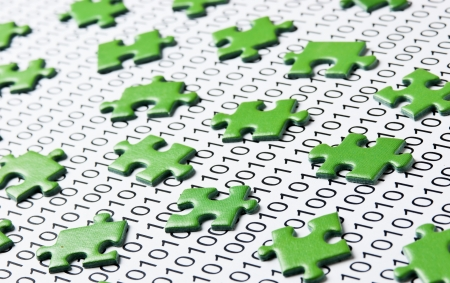 green puzzles and binary code photo