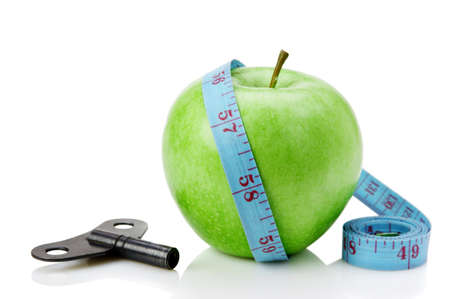 clue: green apple and blue measure tape with clue isolated on white background Stock Photo