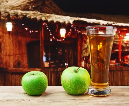 green apple and juice on a wooden table  photo