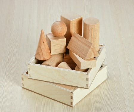 wooden geometric shapes on the table photo