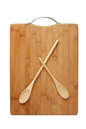 horologe: stylized clock - cutting board and wooden spoons isolated on a white background Stock Photo
