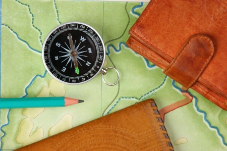 cartographer: compass wallet and passport on the old map