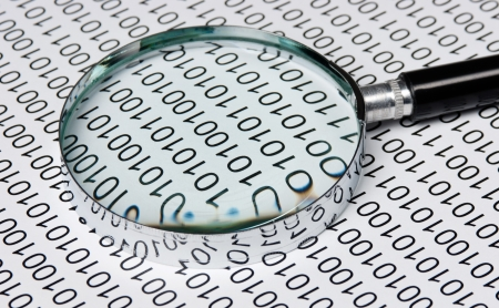 magnifying glass on the background of a binary code Stock Photo - 15884776