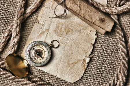 credentials: old paper with compass and rope on canvas