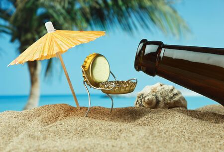 funny cork and bottle on a sandy beach photo