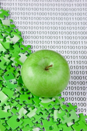 green apple and puzzles on a binary code photo
