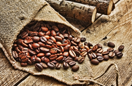 coffee beans in  bag on a old wooden background photo