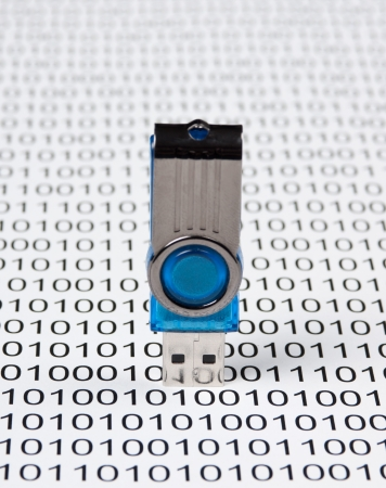 USB flash drive on the background of a binary code photo