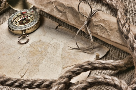 old paper with compass and rope on canvas photo