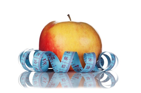 blue measure tape and red apple  isolated on white background