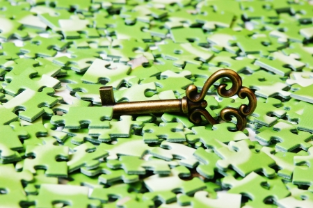 key on pile of green puzzle Stock Photo