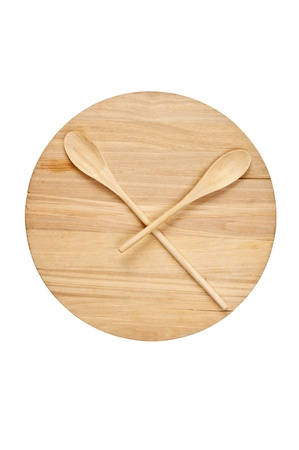 stylized clock - cutting board and wooden spoons isolated on a white background photo