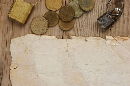 Old paper and coins on a wooden table Stock Photo - 16062562